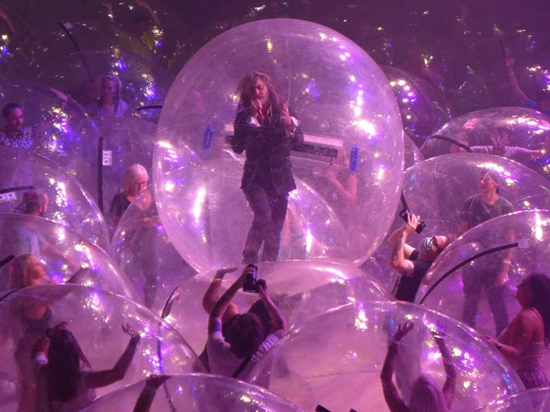 A socially distanced concert held in inflatable bubbles
