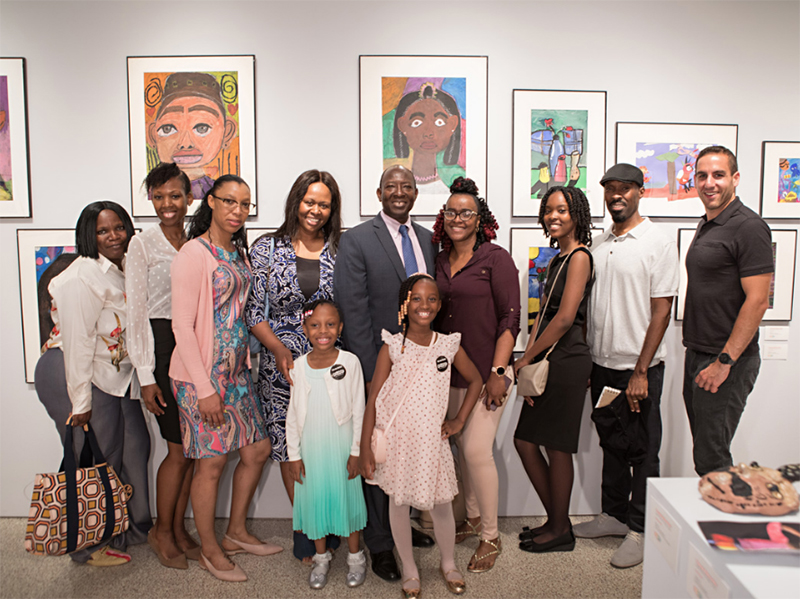 A group of parents and children at the School in a Studio Young Visions exhibition at Christie's NY