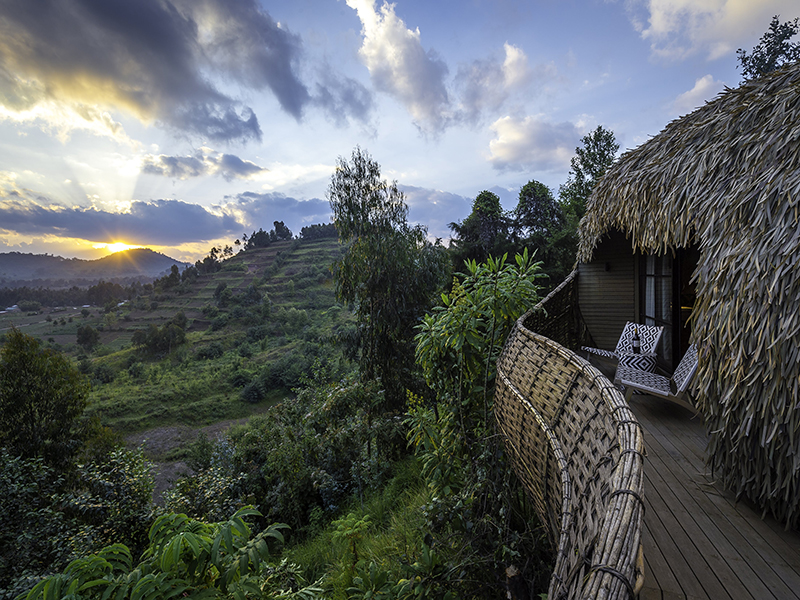 The exterior of a round thatched villa at Bisate Lodge, Rwanda