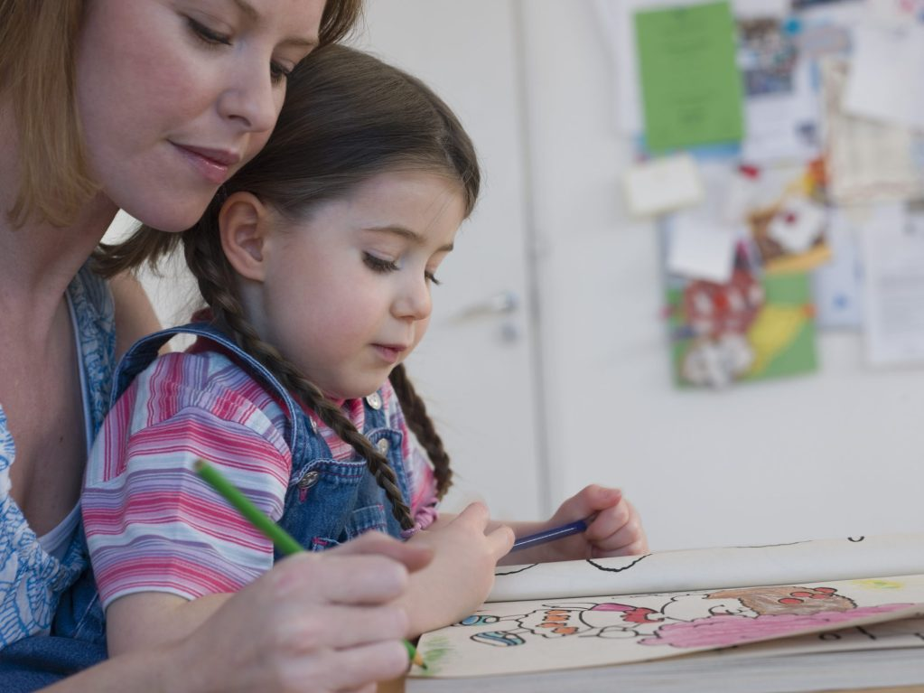 introverted mother coloring with daughter