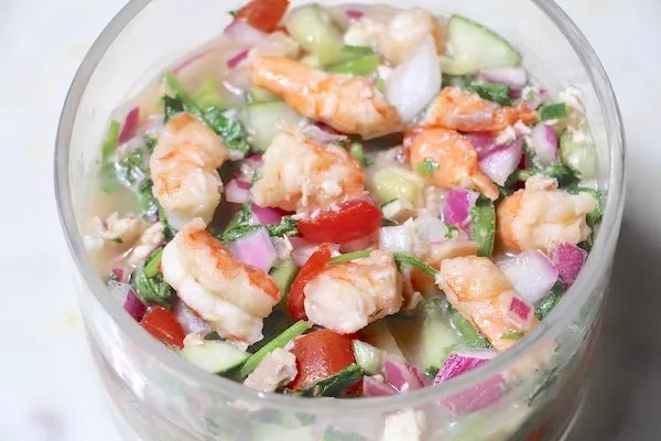 Healthy Shrimp Ceviche in a glass bowl on a kitchen counter