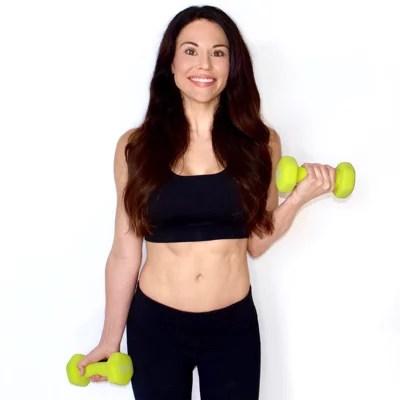 Christina Carlyle holding dumbbells
