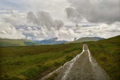 A flat rocky dirt path leading into the distance on the West Highland Way