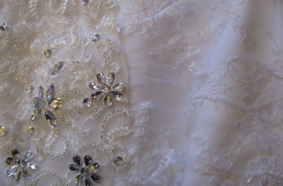 """Cheap Lace Wedding Dresses vs. Lace Wedding Dresses – What's the difference? When you are comparing laces, all are not created equally! The lace of the left is an example of a cheap lace wedding dress fabric. Note the use of embroidery threads to create the """"lace"""" pattern, and the uneven seam. The lace on the right is an example of a much higher grade of lace. Note that individual threads are woven together to create the details, and the holes in the pattern are much closer together. Image courtesy Christine's Bridal & Prom®, Vermont."""