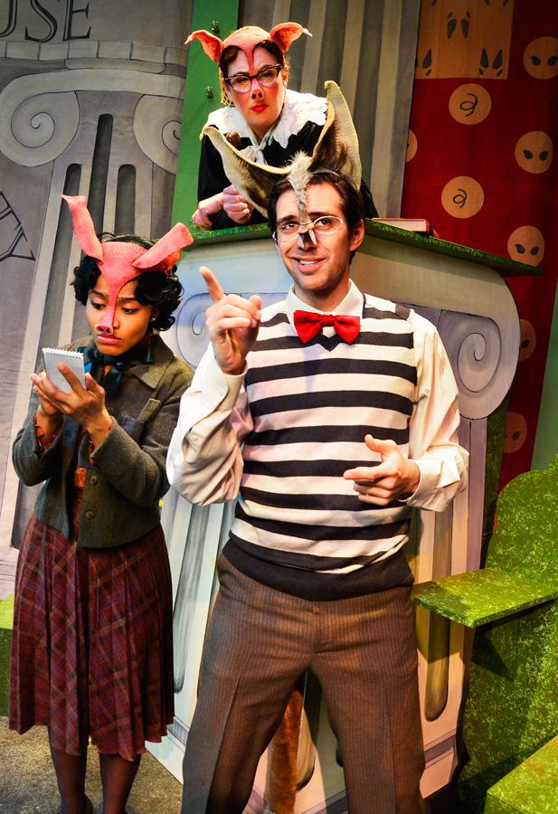 """Alexander T. Wolf, a.k.a """"The Big, Bad Wolf,"""" tells his side of the story to Magil (a piggy reporter) and Judge Prudence. Photo by Suzanne Plunkett."""