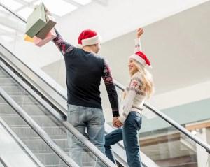 Two people celebrating Christmas shopping.