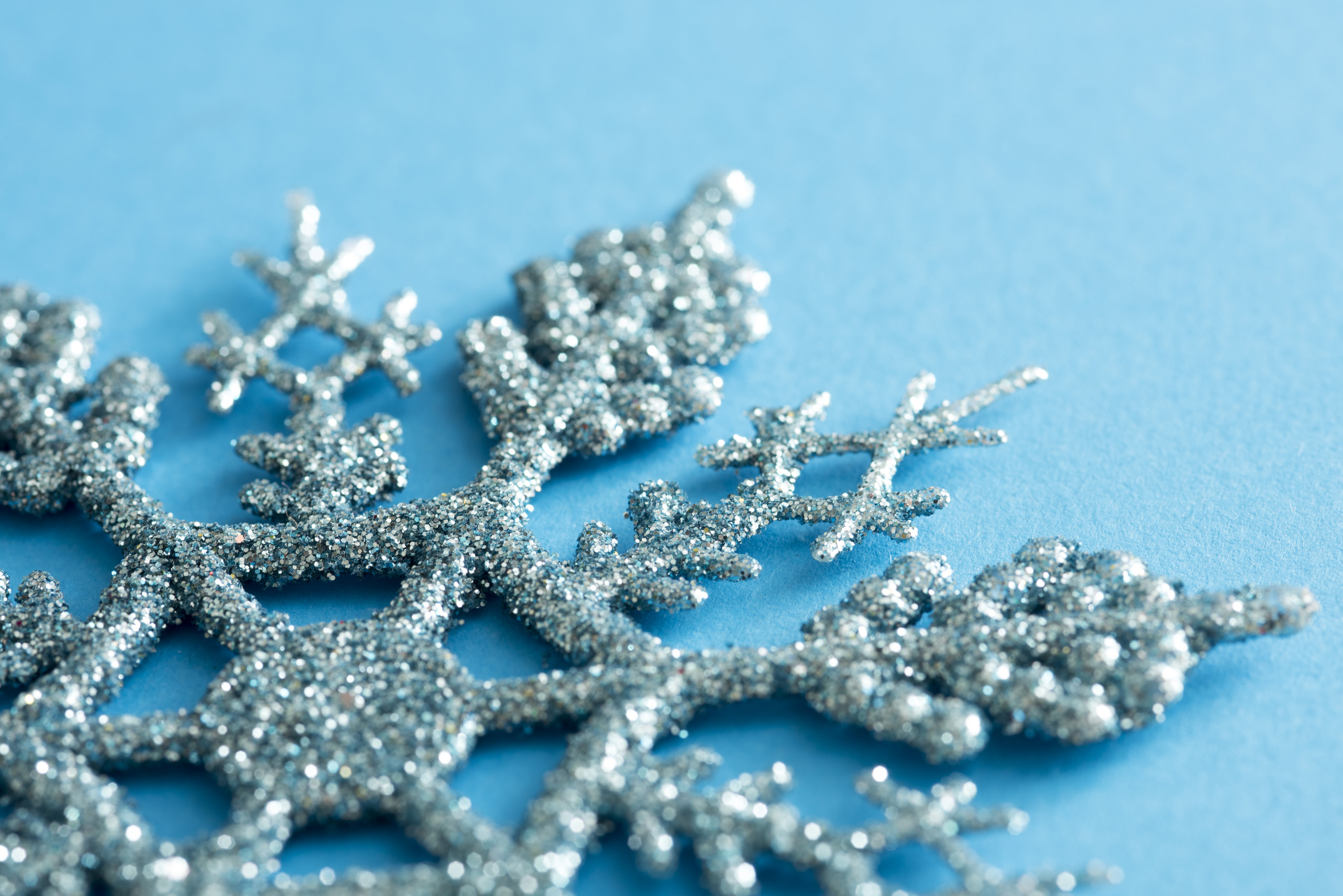 Photo Of Glitter Texture On A Blue Snowflake Decoration