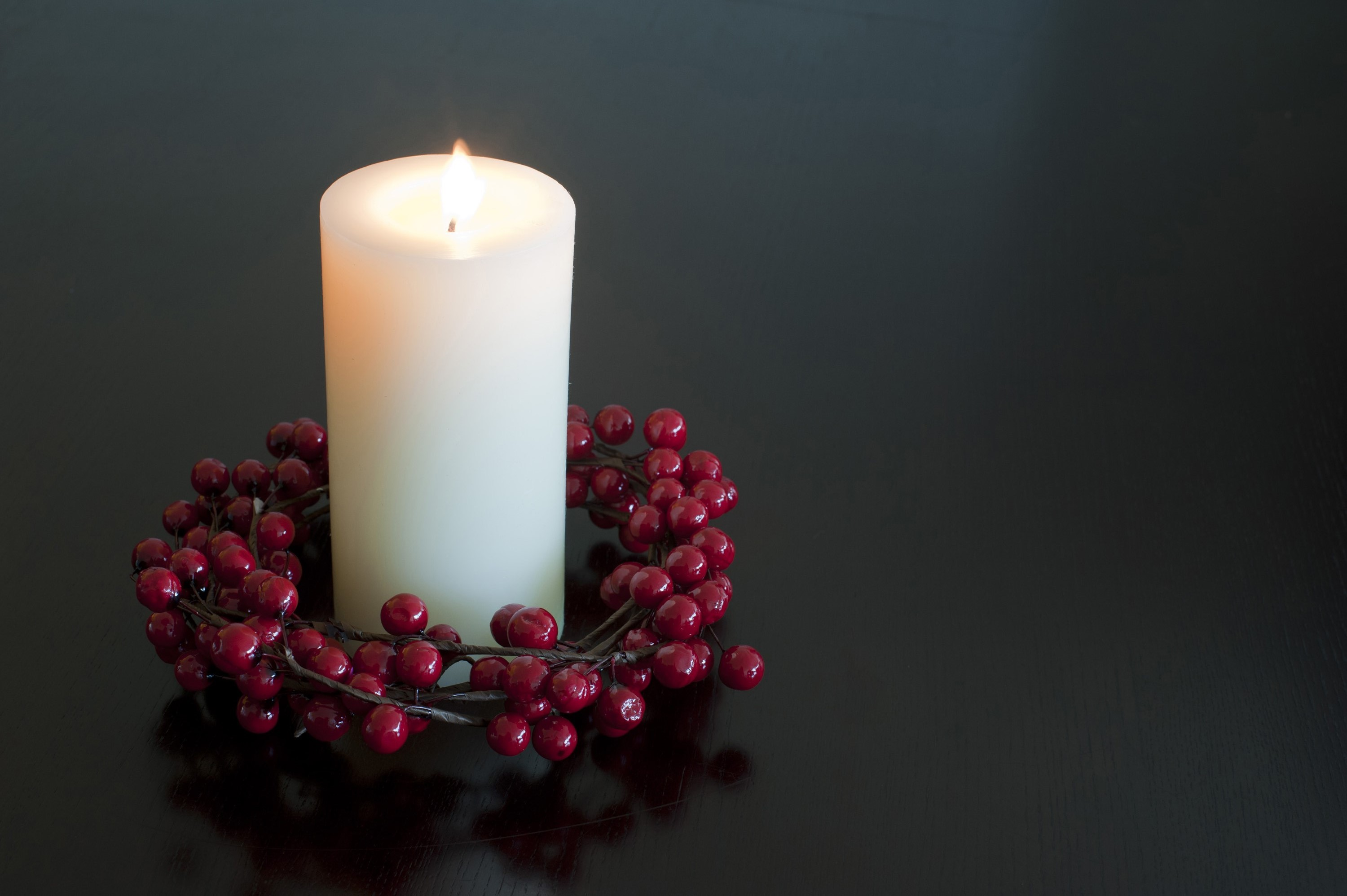 Photo Of Christmas Candle With A Berry Wreath