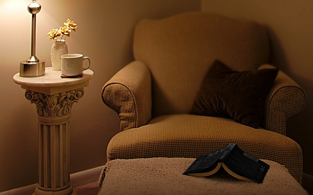 A cozy home reading nook, staged for real estate