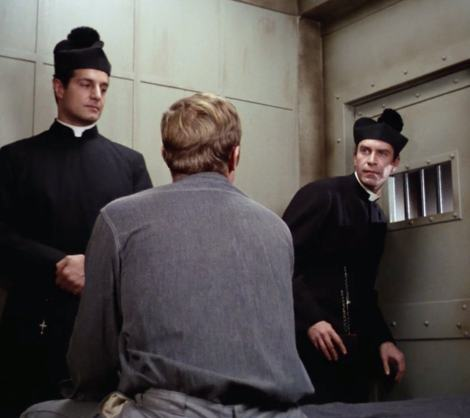 """In """"The Condemned,"""" Willy (Peter Lupus) and Rollin (Martin Landau) masquerade as priests to aid Jim's friend David Webster (Kevin Hagen)"""