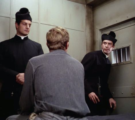 "In ""The Condemned,"" Willy (Peter Lupus) and Rollin (Martin Landau) masquerade as priests to aid Jim's friend David Webster (Kevin Hagen)"