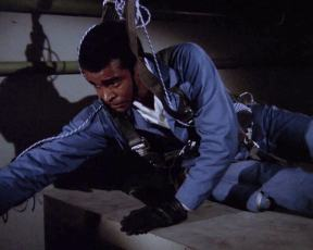 """Barney (Greg Morris) prepares to recover the plutonium core of a nuclear weapon in """"Doomsday"""""""