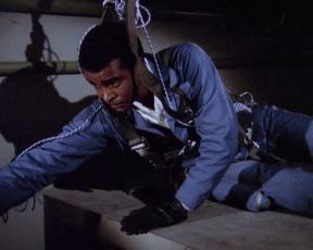 "Barney (Greg Morris) prepares to recover the plutonium core of a nuclear weapon in ""Doomsday"""