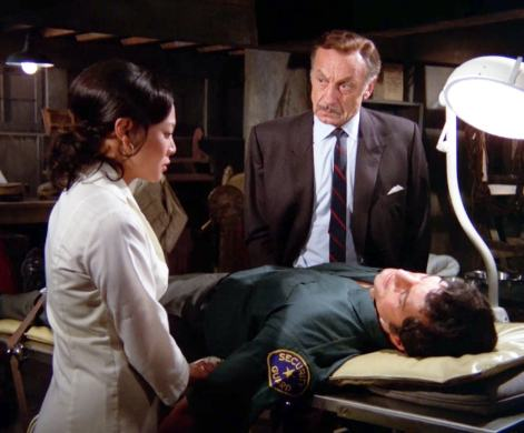 "The captured Willy (Peter Lupus) is tended by sympathetic nurse Penyo (Irene Tsu) and the evil Dr. Matier (Maurice Marsac) in ""Double Dead"""