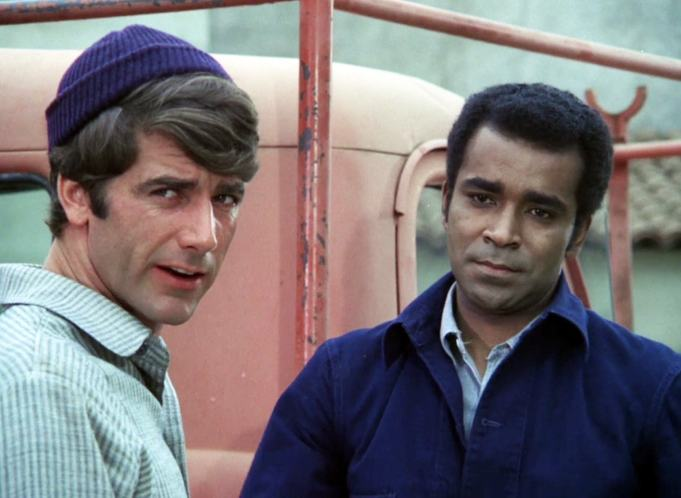 "Working joes Doug (Sam Elliott) and Barney (Greg Morris) explain that their truck has broken down in ""The Rebel"""