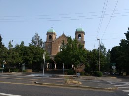 A church sits at the corner of North Williams Avenue and North Rosa Parks Way.