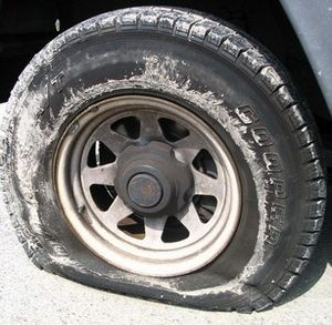 Flat tire. (Photo credit: Wikipedia)