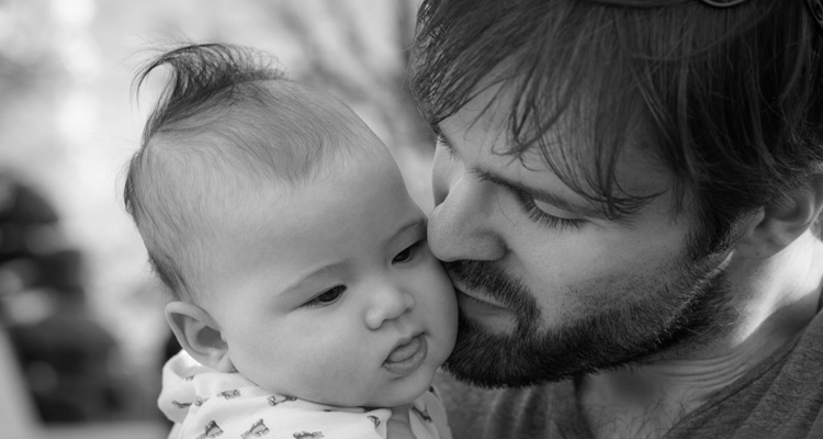 Father kissing a baby
