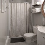 Entire bathroom showing with sink, shower, and toilet.
