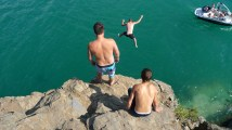 Terry, Dillon on the cliff, and Greg jumping.