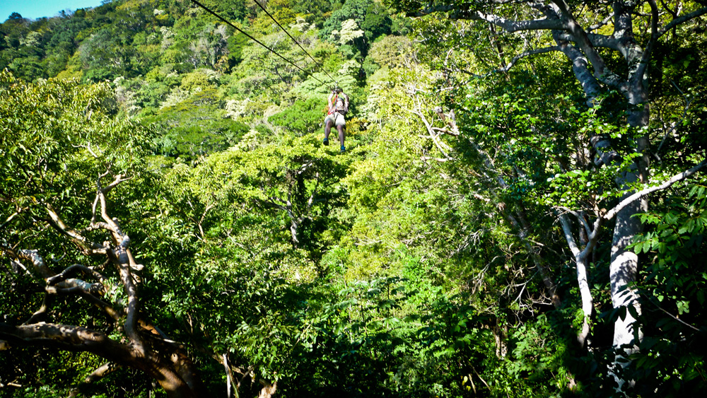 That's me soaring through the treetops flying down one of the larger zip-lines over 1000 feet long. The braking is manual with a thick leather glove, so you can get going ridiculously fast.