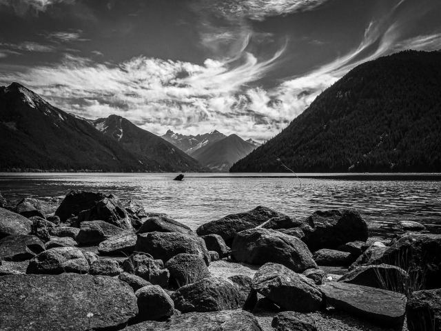 Another day at Chilliwack Lake with porous rocks in the foreground, and cool clouds in the background.