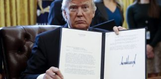 FILE: President Donald Trump of America displays the executive order banning citizens of seven countries from entering the US