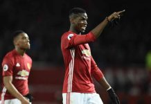 Man Utd French dou Anthony Martial (L) walks with Paul Pogba