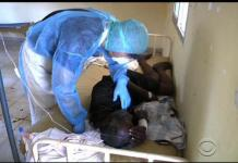 Ebola patient being attended to
