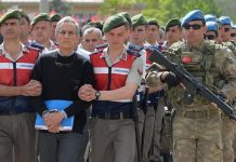 One of the alleged coup plotters being led into a court room in Ankara Turkey