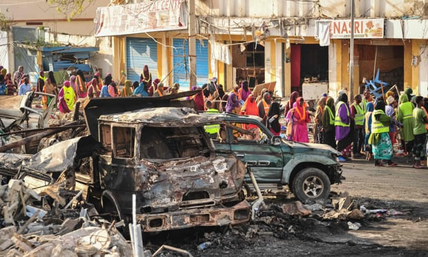 Destroyed vehicles in the centre of Mogadishu. Officials fear the death toll will continue to rise.