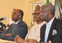 FILE PHOTO: Rotimi Amaechi (L) and Babatunde Fashola (R) are ministers in President Muhammadu Buhari's government