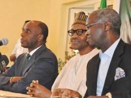 FILE PHOTO: Rotimi Amaechi (L) and Babatunde Fashola (R) are ministers in President Muhammadu Buhari's government