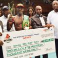 """FILE PHOTO: Stanley """"Edo Boy"""" Eribo with the N2.5 million cheque after retaining his African Boxing Union (ABU) welterweight title by defeating Tanzania's Ramadhani Shauri via a unanimous decision at GOtv Boxing Night 12"""
