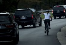 "Despite losing her job, the 50-year-old says she does not regret ""flipping off"" the motorcade"