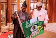 FILE PHOTO: Governor Ibikunle Amosun presenting a birthday card to President Muhammadu Buhari in 2017
