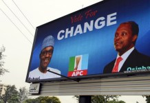 FILE - An electronic billboard displays a campaign billboard of President Muhammadu Buhari and Prof Yemi Osinbajo before the 2015 presidential election
