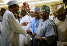 President Buhari having a chat with the governors after the meeting