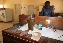 FILE: A technician looks at unfinished artificial leg in the ICRC workshop inside the Dala National Orthopaedic Hospital