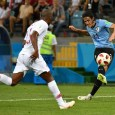 Edison Cavani scored twice as Uruguay beat Portugal to reach the quarter-final