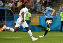 Edison Cavani scored twice as Uruguay beat Portugal to reach the quarter-final