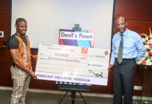 Kukogho Iruesiri Samson who wrote Devil's Pawn presented with a one million naira cheque by Segun Agbaje, GTB MD/CEO