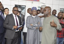 Minister of Information and Culture, Alhaji Lai Mohammed (middle); Special Assistant 1 to the President on Information and Culture, Mr. Segun Adeyemi (left) and the Secretary Transport Secretariat of the Federal Capital Territory Administration, Mr. Kayode Opeifa, during a facility tour of the Abuja Light Rail Project by the minister on Thursday