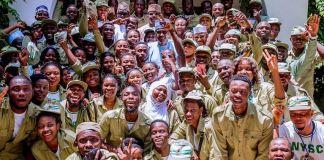 President Muhammadu Buhari and NYSC members in Daura, Katsina state graduates