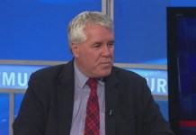 Senate minority leader Jeff Woodburn says he'll fight domestic violence charges in court