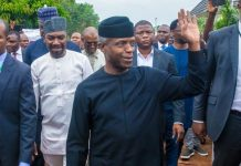 Vice President Yemi Osinbajo acknowledges cheers from the crowd outside Human Rights Radio in Abuja, Nigeria's capital