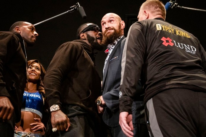 Deontay Wilder and Tyson Fury square up ahead of their heavyweight bout in Los Angeles