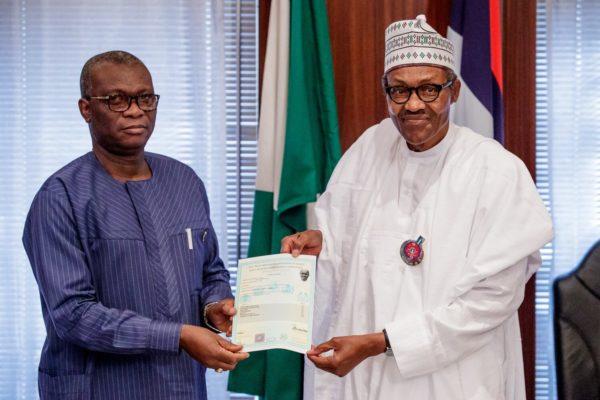 Dr Iyi Uwadiae, WAEC registrar presents President Muhammadu Buhari's West African Examination Council school certificate