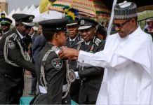 President Muhammadu Buhari commissions a cadet in Kano, Northern Nigeria
