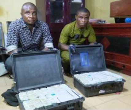 Suspected money launderers Ezekwe Emmanuel (L) and Igboh Augustine (R) arrested with $2.8 million at Akanu Ibiam Int'nl Airport,Enugu